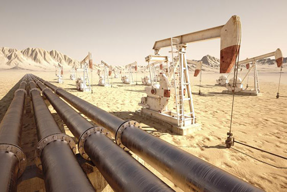 Oil field pumpjacks and CO2 pipelines in the desert.