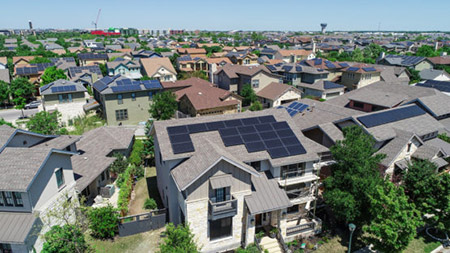 photo of many homes with rooftop solar panels