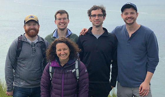 Fervo Energy team members group photo on a hike with San Francisco bay in the background