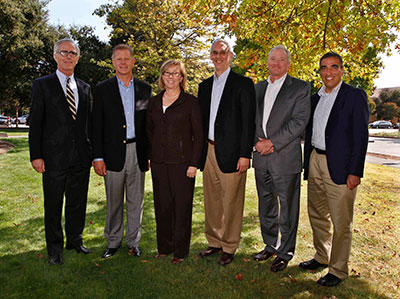 GCEP management committee team members standing in line in front of a tree