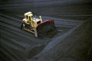 A front loader piles coal at a power plant in New York.