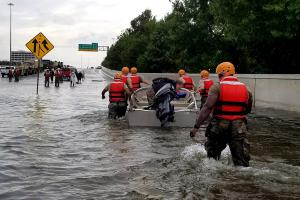 Soldiers with the Texas Army National Guard move through flooded Houston streets as floodwaters from Hurricane Harvey continue to rise, Aug. 28, 2017.