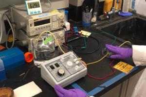 Stanford University postdoc Chong Liu demonstrates the operation of an electrode filter for extracting uranium from seawater.