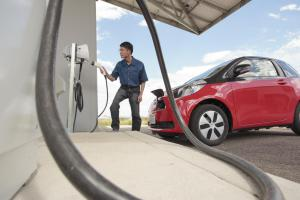 Researcher Myungsoo Jun at an electric vehicle charging station at NREL in Colorado.