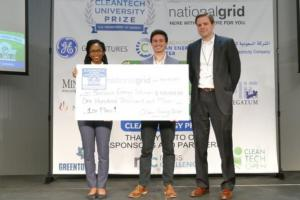 Solstice Energy Solutions co-founders Ugwem Eneyo (left) and Cole Stites-Clayton (center) stand with Kristian Bodek of National Grid.