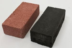 An ordinary construction brick, left, and an experimental brick made of a protein/lunar regolith mixture.
