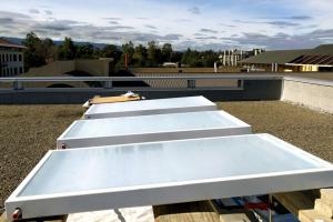 A fluid-cooling panel designed by Professor Shanhui Fan and former research associates Aaswath Raman and Eli Goldstein being tested on the roof of Stanford's Packard Electrical Engineering Building.