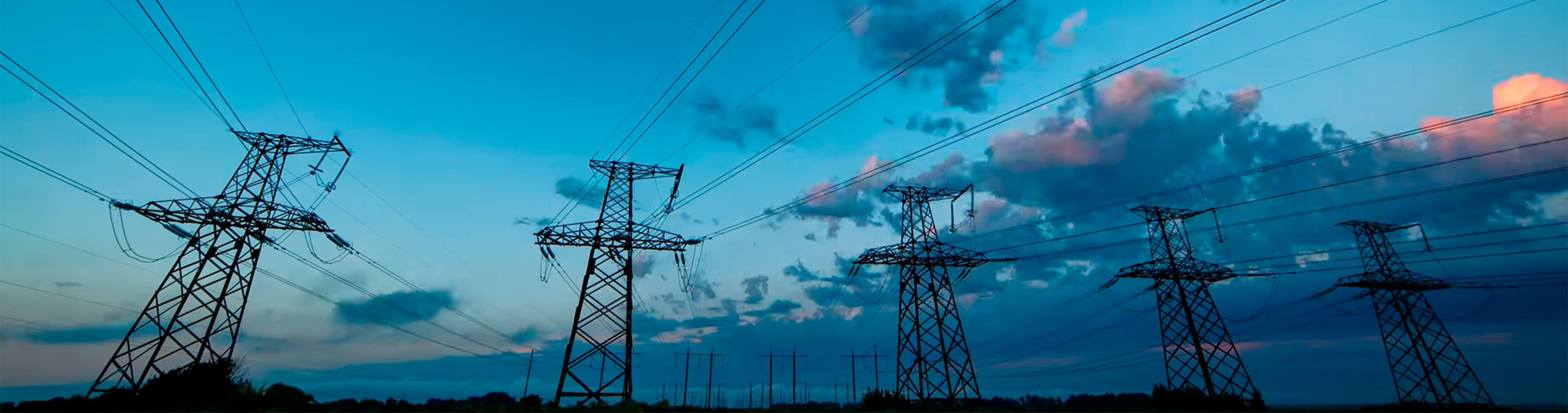 Transmission lines with blue evening sky in background