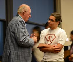 Graduate student talking to former Secretary of State George Shultz