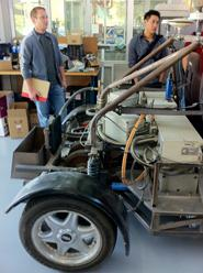 Two students looking at assembly of car at factory lab tour
