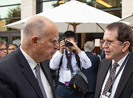 Gpv. Jerry Brown talks with Jaime Parada, director general of the Institute of Innovation and Technology Transfer