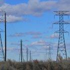 Transmission lines with cloudy blue sky