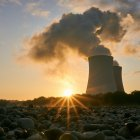 Nuclear power plant cooling tower at sunrise