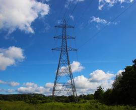 Single electric grid with blue sky and clouds in the background
