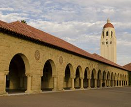 Hoover tower in back of Stanford quad arches
