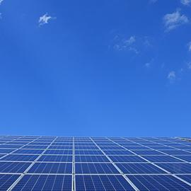 Solar panels with blue sky in background