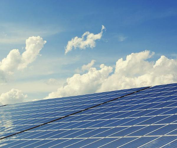 Photovoltaics with blue sky and clouds in background
