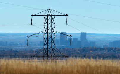 Power line with city in background