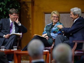 Stanford's Jeffrey Ball, Bank of America Vice Chairman Anne Finucane and John Kerry in a lighter moment of their discussion to open the conference