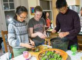 Netta Wang, Sarah Dobbins and Spencer Guo make a salad from the organic greens grown in the Roble garden.