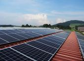 Solar panels on rooftop with mountain in the background