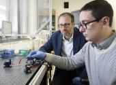 Alberto Salleo, associate professor of materials science and engineering, with graduate student Scott Keene characterizing the electrochemical properties of an artificial synapse for neural network computing.