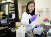 Stanford postdoc Chong Liu examines a carbon-amidoxime electrode as part of research to improve extraction of uranium from seawater.