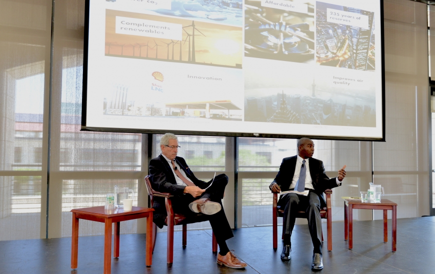 """Stanford geophysics professor Mark Zoback, director of the Stanford Natural Gas Initiative, moderates a discussion with Philip Mshelbila, general manager of gas and director of the Shell Petroleum Development Company of Nigeria Ltd. Their conversation, titled """"Addressing the Ambition Gap,"""" detailed the challenges of alleviating energy poverty in Nigeria."""